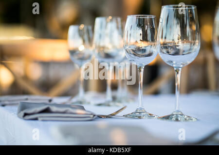Luxury table settings for fine dining with and glassware, beautiful blurred  background. Preparation for holiday - Stock Photo