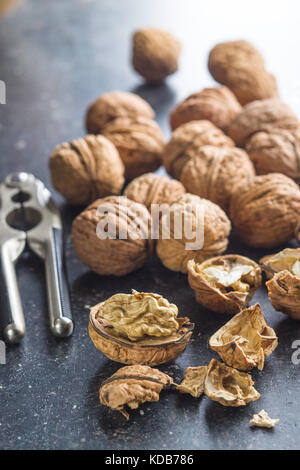 Tasty dried walnuts with nutcracker. - Stock Photo