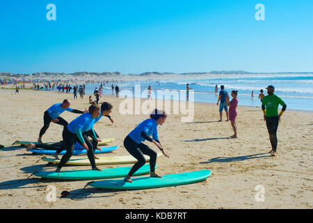BALEAL, PORTUGAL - JUL 30, 2017: Coach show how to surf to the group of surfers. Ericeira is the famous surfing - Stock Photo
