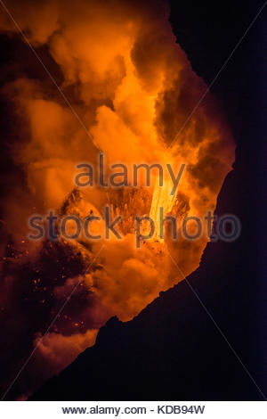 Lava falling from sixty feet creates an explosion from the heat and pressure of super heated water. - Stock Photo