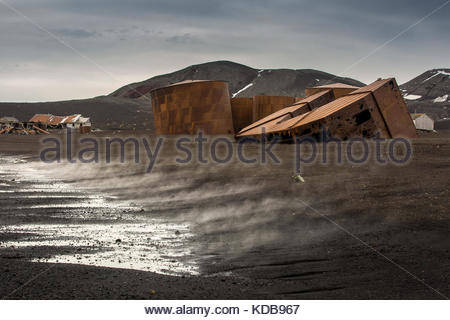 The old abandoned whaling station on Deception Island, Antarctica. - Stock Photo