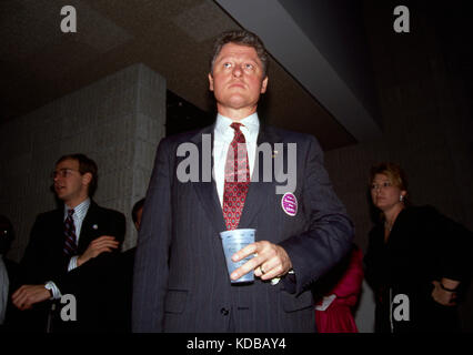 A youthful looking Arkansas Governor Bill Clinton waits his turn backstage before a speech to Georgia Democrats - Stock Photo