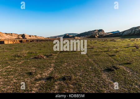 Stone rocks and green hills in a mountainous area - Stock Photo