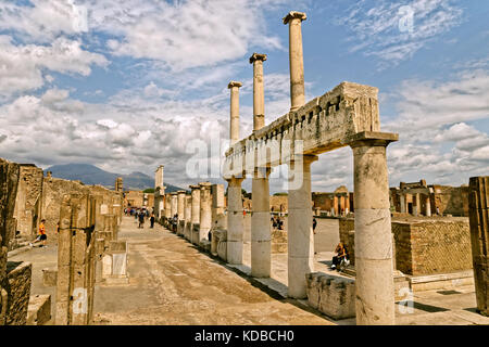 Arcadian way with doric columns at the Forum in the ruined Roman city of Pompeii at Pompei Scavi near Naples, Italy. - Stock Photo
