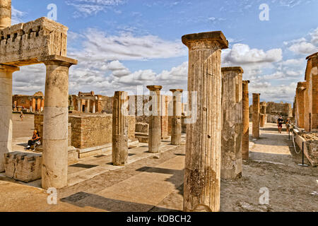 Columns at the Forum area in the ruined Roman city of Pompeii at Pompei Scavi near Naples, - Stock Photo