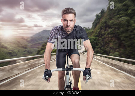 Athletic Man on a bicycle - frontal view - Stock Photo