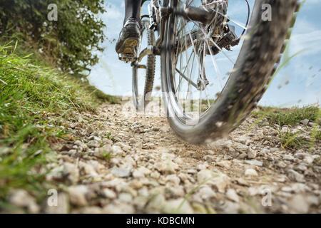 Mountain Bike on a dirt road - Stock Photo