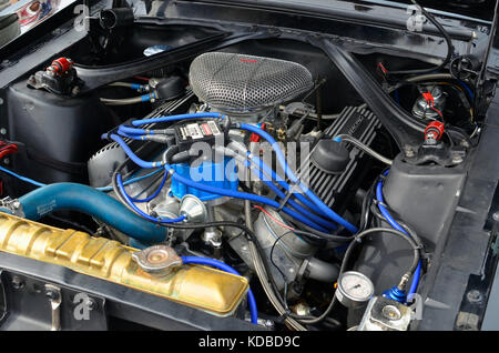 Meeting of classic american cars, in Torrejon de Ardoz (Madrid - Spain). Powerful engine V8 of Ford Mustang (First - Stock Photo
