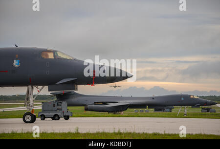 U.S. Air Force B-1B Lancer bombers with the 37th Expeditionary Bomb Squadron prepares to take off to join the Japan - Stock Photo