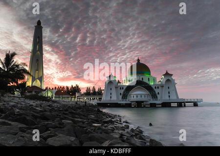 Long exposure image of Strait Mosque of Malacca captured during sunrise. - Stock Photo