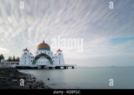 Long exposure image of Strait Mosque of Malacca captured during sunrise - Stock Photo