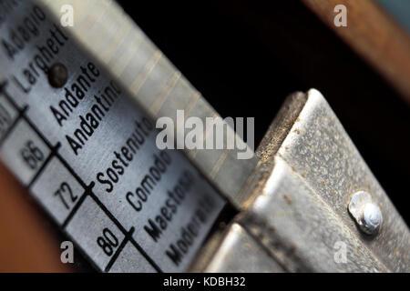 Old metronome close-up - Stock Photo