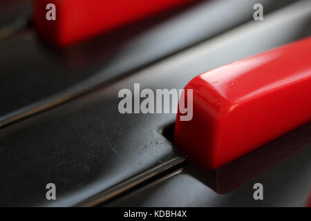 Closeup of black and red keys of melodica keyboard. - Stock Photo
