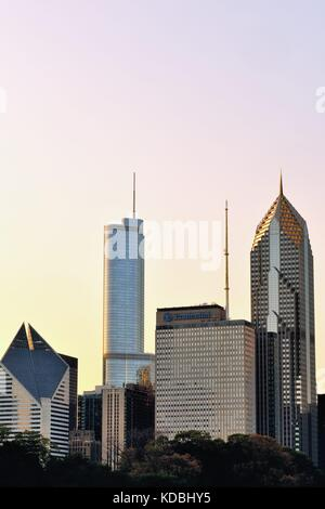A portion of the Chicago skyline above the north end of Millennium Park basks in the glow of the late afternoon - Stock Photo