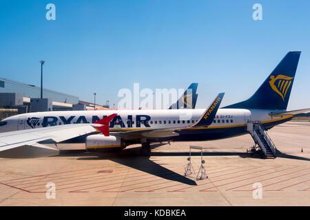 A Ryanair passenger plane at Malaga international airport Pablo Ruiz Picasso. Costa del Sol, Andalusia. Southern - Stock Photo