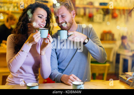 Romantic couple having date in coffee shop - Stock Photo
