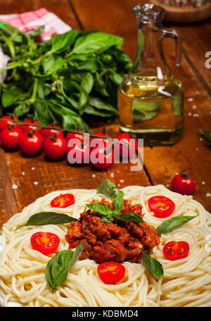 Plate of delicious spaghetti Bolognaise or Bolognese with savory minced beef and tomato sauce garnished with parmesan - Stock Photo
