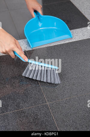 Maid Cleaning The Floor With Mop In Office - Stock Photo