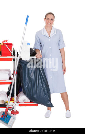 Female Cleaner With Cleaning Equipment Isolated On White Background - Stock Photo