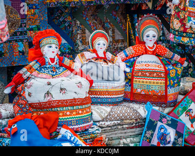 Slavic rag doll. Handmade rag doll woman, in traditional ethnic russian costume. Souvenirs from Russia - Stock Photo
