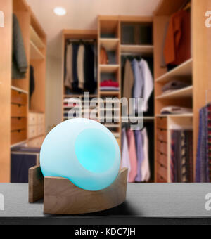 Colored air freshener in glass container in modern dressing room - Stock Photo
