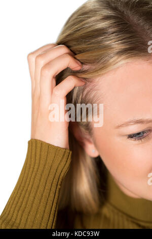 Studio Shot Of Young Woman Itching Scalp - Stock Photo