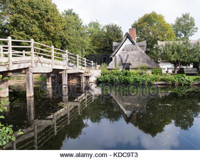 Bridge Cottage, looking across the River Stour, Flatford, Suffolk - Stock Photo