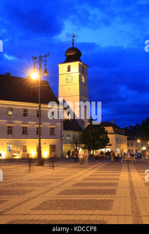 The Council Tower on the Big Square (Piata Mare) at dusk, in Sibiu, in Transylvania, in Romania - Stock Photo