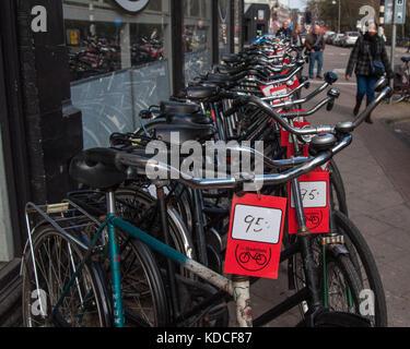 bicycles lined up for sale outside a bike shop in. Black Bedroom Furniture Sets. Home Design Ideas