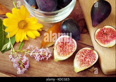 autumn composition - ripe figs and flowers. Ripe sweet figs . Healthy mediterranean fig fruit . - Stock Photo