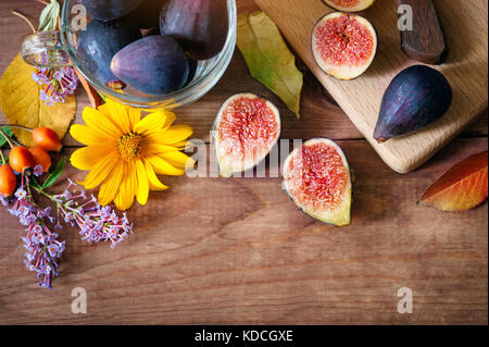 autumn composition - ripe figs and flowers. fruits and vegetables - Stock Photo