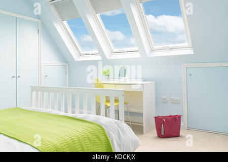 A bright, fresh bedroom in a loft conversion with double bed, modern furniture and Velux rooflight windows.