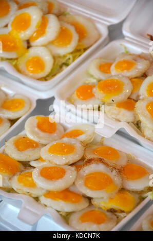 Fried quail eggs, delicious Thai street food - Stock Photo
