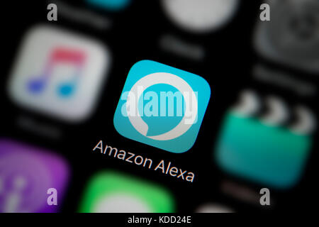 A close-up shot of the logo representing Amazon Alexa icon, as seen on the screen of a smart phone (Editorial use - Stock Photo