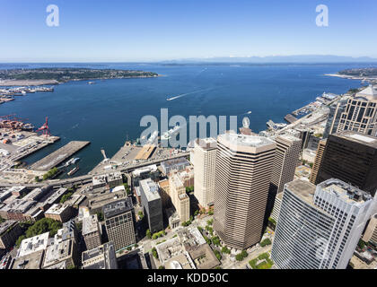 Aerial view of Seattle container port and ferry terminal buildings and the south of the business district in Washington - Stock Photo