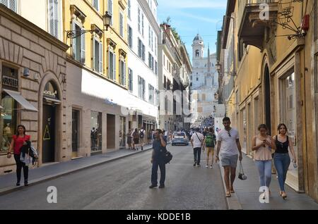 People walking through Via dei Condotti-Street in Rome, Italy - Stock Photo