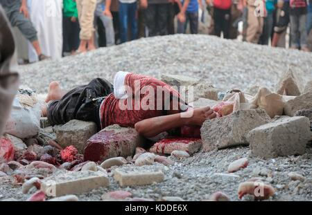 EDITORS NOTE: GRAPHIC CONTENT. Undated ISIS propaganda image showing a man killed by stoning for sodomy during a - Stock Photo