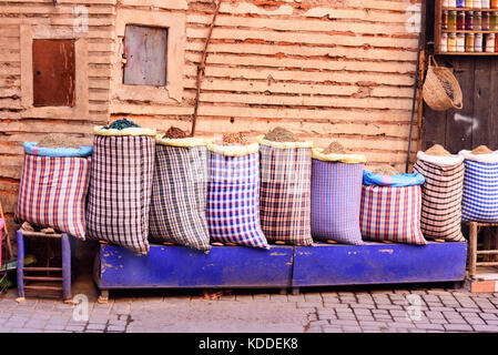 Big bags with herbs and spices in market at medina. Marrakesh. Morocco - Stock Photo