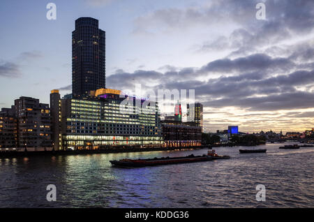 London Southbank Skyline - Southbank Cityscape - River Thames Traffic passes Sea Containers House complex and the - Stock Photo