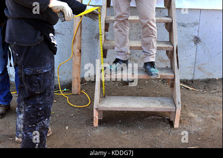Builders working on a construction site in Canada. - Stock Photo