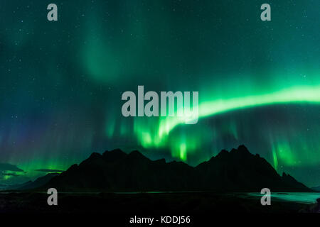 Stokksnes and Vestrahorn with the Northern Lights (Aurora Borealis) Near Hofn, Iceland - Stock Photo