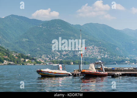 Como, Italy - May 27, 2016: Moored rescue boats on Como lake in Como City, Italy. - Stock Photo