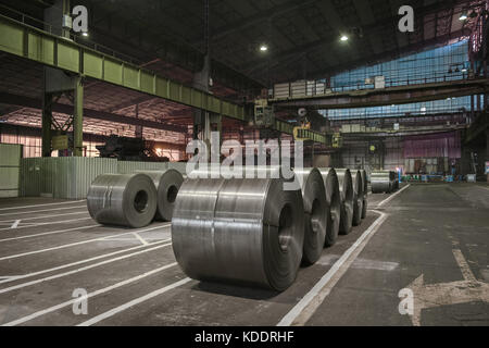 Raw steel coils ready for production in the steel mill - Stock Photo