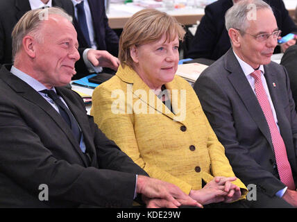 Hanover, Germany. 12th Oct, 2017. German Chancellor Angela Merkel (CDU) sits next to the chairman of the IG BCE, - Stock Photo