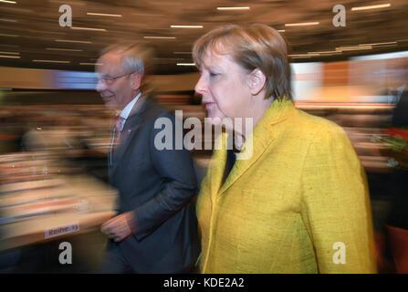 Hanover, Germany. 12th Oct, 2017. German Chancellor Angela Merkel (CDU) walks next to the chairman of the IG BCE, - Stock Photo