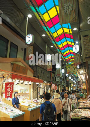 View looking along an aisle inside Nishiki Market in downtown Kyoto in Japan - Stock Photo