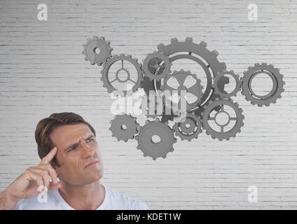 Digital composite of man looking up at question mark - Stock Photo