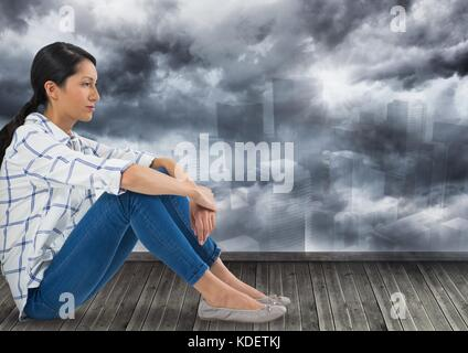 Digital composite of Businesswoman sitting over city - Stock Photo