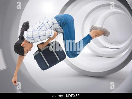 Digital composite of Businesswoman with briefcase floating through minimal tunnel - Stock Photo