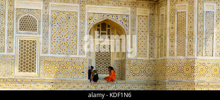 Women sheltering from the heat at the Tomb of Itimad-ud-Daulah (baby Taj Mahal) in Agra, India - Stock Photo